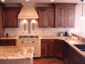 Magenta Wooden Cabinets with Beautiful Stove and Island - Kitchen