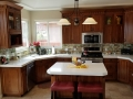 Grand Contrasting White Countertops against Hazel Cabinets