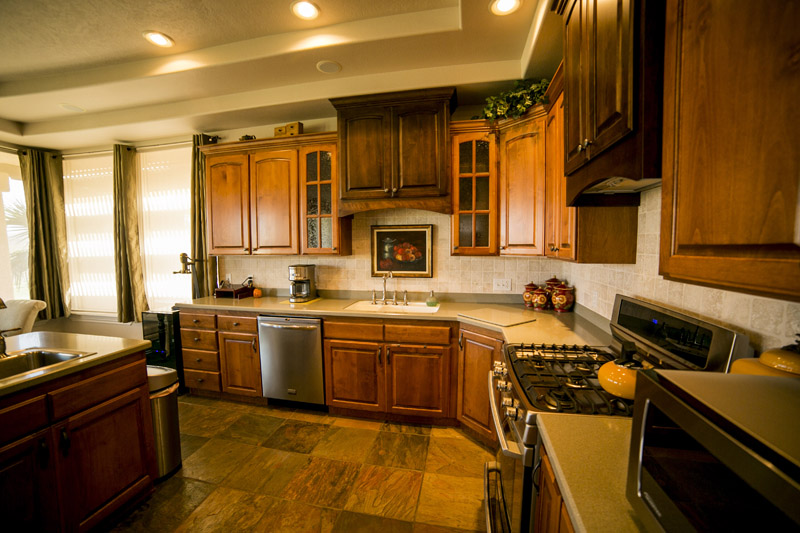 Brown Cabinet Kitchen with Tan Ceiling